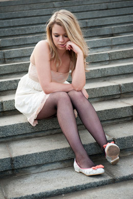 distraught girl sitting on stairs